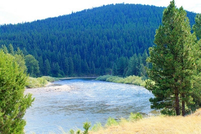 Blackfoot River flowing away from the viewer at Corrick's River Bend entrance road looking south.