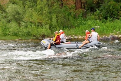 Seniors on an inflatable raft on the Blackfoot River entering the Thibodeau rapids on 7/28/17