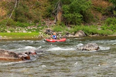 Kayaking the Blackfoot River at the beginning of Thibodeau Rapids