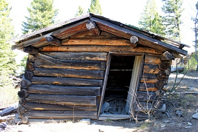 The only cabin I saw in Coloma (ghost town) Montana that has not yet collapsed.  There is also an old rusted barrel type wood stove inside.