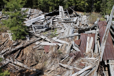 Completely collapsed structure (or is it 2 or 3 structures?) in the main part of Coloma (ghost town) Montana