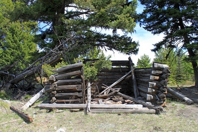 Second of several collapsed cabins seen upon entering Coloma (ghost town) Montana