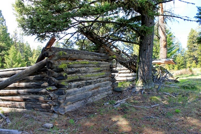 One of several collapsed cabins seen upon entering Coloma (ghost town) Montana
