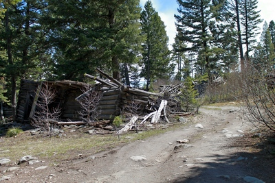 Very rough road to the main part of Coloma (ghost town) with a collapsed cabin on the left.