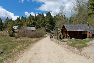 Main entrance road with the staff office cabin on the right which is one of the better preserved cabins but occupied for staff only.