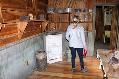 Diana browsing the kitchen of the Wells Hotel in Garnet Ghost Town.