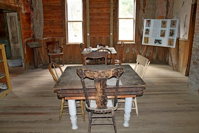 Dining area in the Wells Hotel in Garnet, MT.  Most of the remaining buildings  in Garnet have been stabilized to make it safe for visitors to explore.  Two vertical support posts can be seen in the middle of  the far wall to add rigidity to the structure.