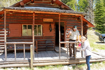 Diana speaks with a BLM volunteer at the staff office cabin.  Having been built in 1949, the Bill Hübner cabin is one of the better preserved cabins in Garnet.  For staff only... do not enter.