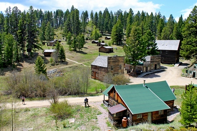 Overview of most structures seen upon entering Garnet (ghost town) by foot from the parking lot.  In the foreground was the remodeled home of Ole and Marion Dahl who moved there in 1938.  They built their own saloon, Dahl's Bar, just down the street.  This cabin can be rented in the winter.