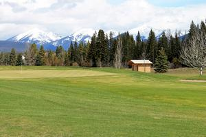 Overlooking the Double Arrow Resort golf course with the Swan mountains as a backdrop.