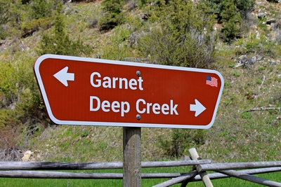 Sign at Beartown, Montana (2.2 miles south of Garnet) indicating which way to Garnet Ghost Town and Deep Creek Montana