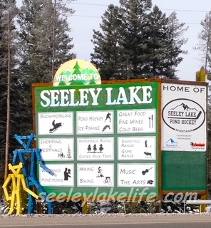 Welcome to Seeley Lake Montana - town road sign (as you've never seen it).