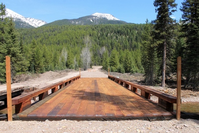 Looking east across the new wooden bridge crossing Morrell Creek on FR 4381 on the way to Morrell Falls trailhead and Pyramid Pass trailhead as it appeared 5/11/17.  The bridge and forest have sustained heavy damage in the Rice Ridge fire.  The bridge never opened and will already require rebuilding.  No public pictures are available of this area since the fire is still active as of 8/6/17.