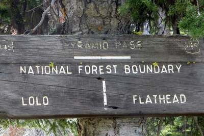 Sign at Pyramid Pass, National Forest Boundry - Lolo Flathead Seeley Lake, MT