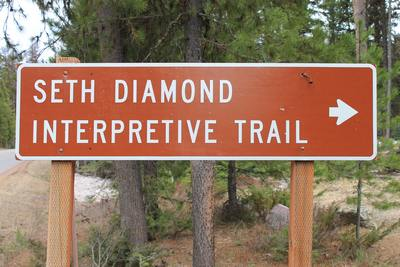The Seth Diamond Interpretive Trail Trailhead about 1 mile north of the Seeley Lake Campground on Boyscout Road