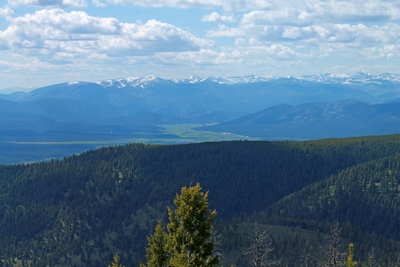 View from the top of Union Peak, Montana looking west to the Potomac Valley, and the Rattlesnake Mountains with McLeod Peak (8,620 ft.) in the distance.